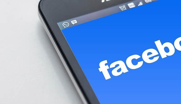 Facebook logo displayed on smart phone