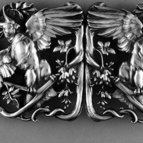 Cast and chased silver waist-clasp (in two pieces) in the form of two parrots on branches by Louis Armand Rault