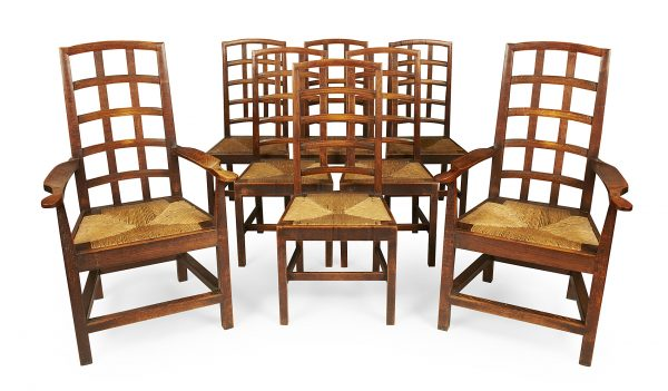 Set of eight elm chairs by Ernest Gimson