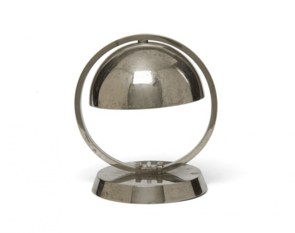 Table lamp for Damon in chromed metal with fixed hemispherical cap on a hollow circle and a round, flat base.