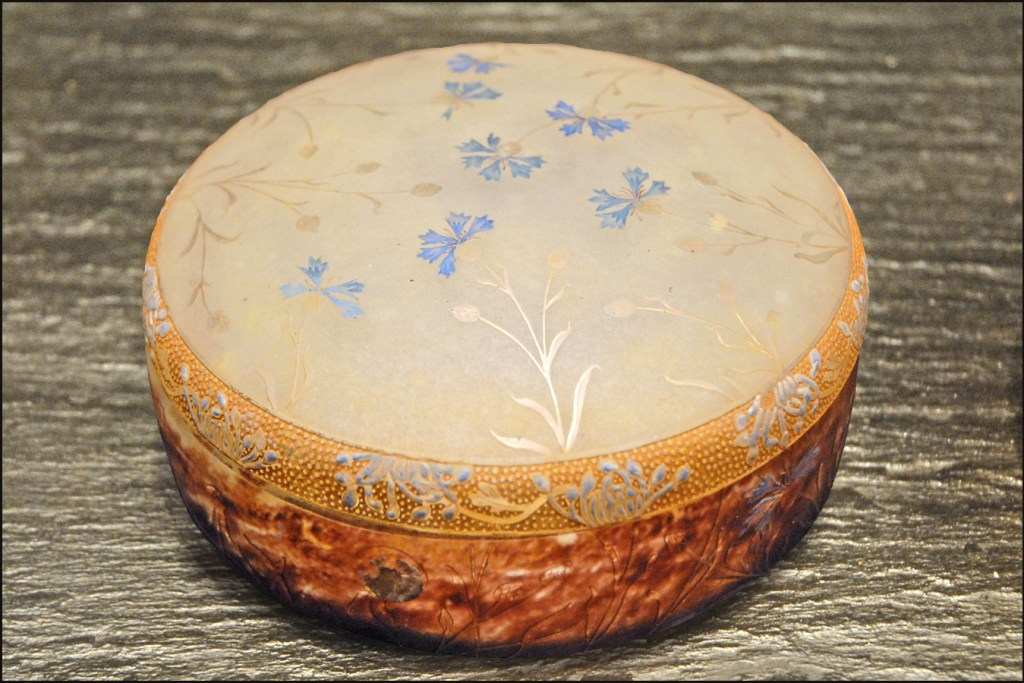 Daum Bonbon container with cornflower design of engraved glass, enamel, and gold by Daum (1901)