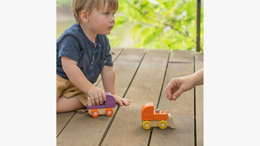 Benefits of Educational Toys - Child Playing with Trucks