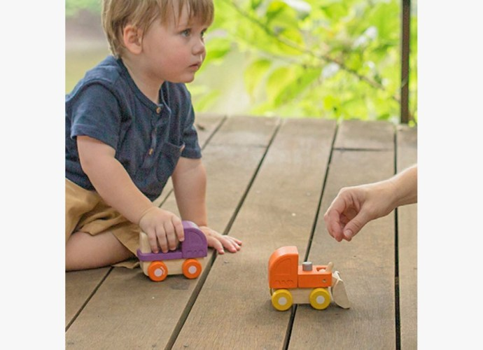 Child Playing with Trucks