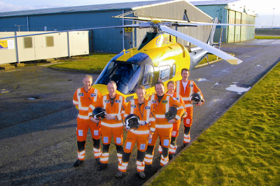 Air ambulance crew with helicopter