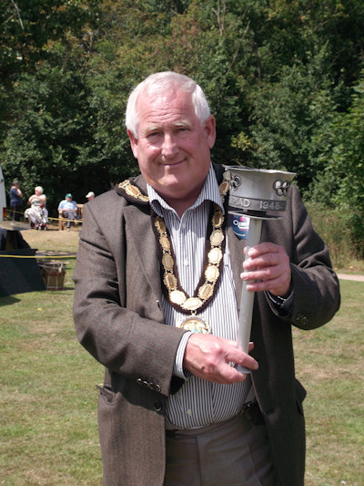 Cllr Barry Garner holding 1948 London Olympic Torch