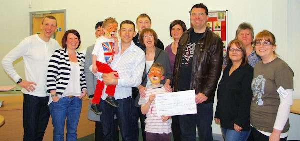 Your Thorpe Astley team present cheque to LAMP