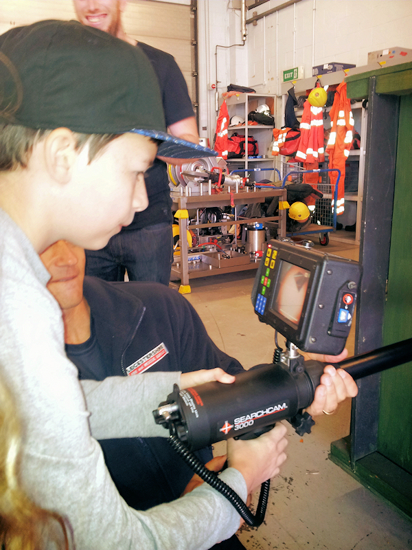 Another young visitor gets hands on with state of the art camera technology