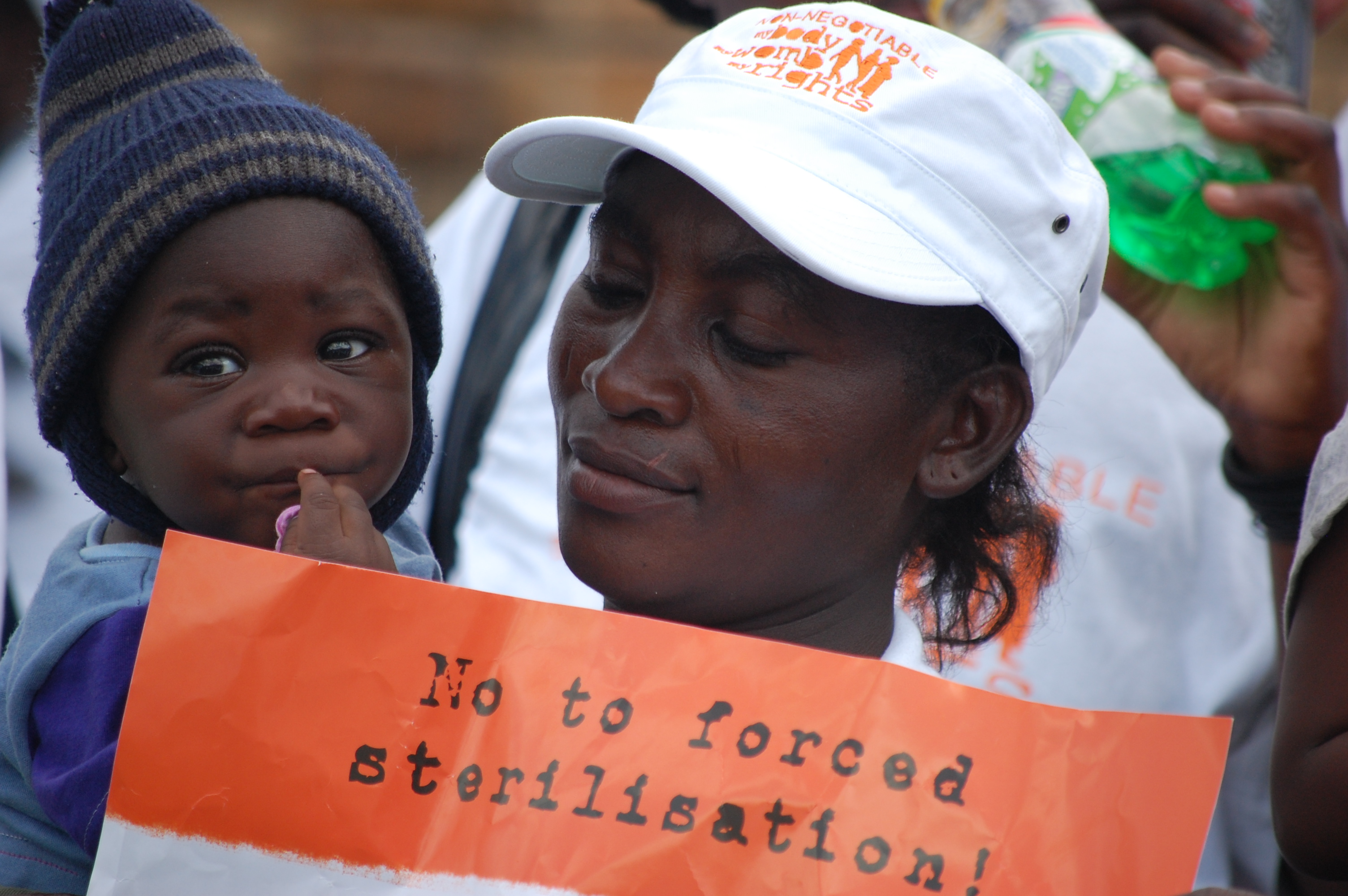 Women and baby marching for an end to forced sterilization