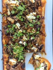 Trevor's at the Tracks flatbread with mushrooms, figs, caramelized onions, goat cheese, and micro arugular