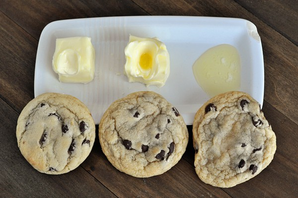 Three cookies with varying degrees of melted butters to show how the butter's coldness affects the cookies shape.