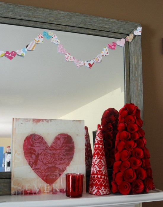 Make a garland out of scrapbook paper hearts sewn together! Easy and adorable!