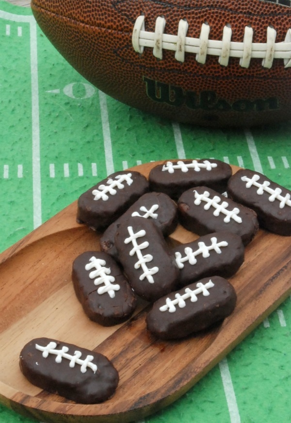 These Mounds Footballs would be so cute for tailgating! And you can make them in minutes!