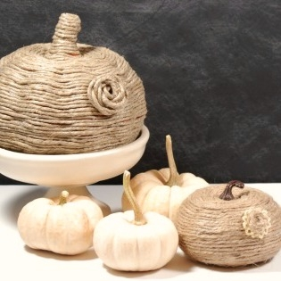 These jute-wrapped pumpkins are a gorgeous and easy-to-make alternative to traditional orange pumpkin decor.