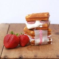 These strawberry shortcake waffle ice cream sandwiches are so good and easy to make -- you cook boxed pound cake right in your waffle maker! What a perfect summer treat.