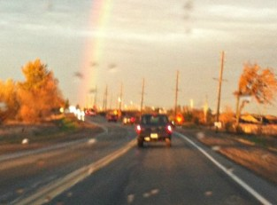 Beautiful Rainbow, even though the photo was taken while driving.