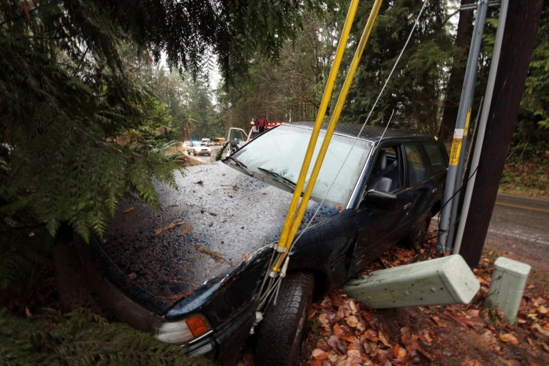 """""""A car that skidded off the road into a power pole is winched away by a tow-truck while the sheriff holds up traffic. Note: the young, inexperienced, extremely lucky driver was unharmed."""""""
