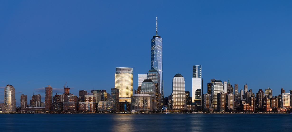 The glass walls of lower Manhattan shimmer in the sun