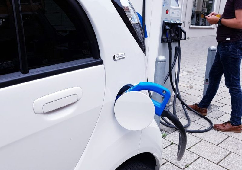 an electric vehicle gets a charge at a public charging station