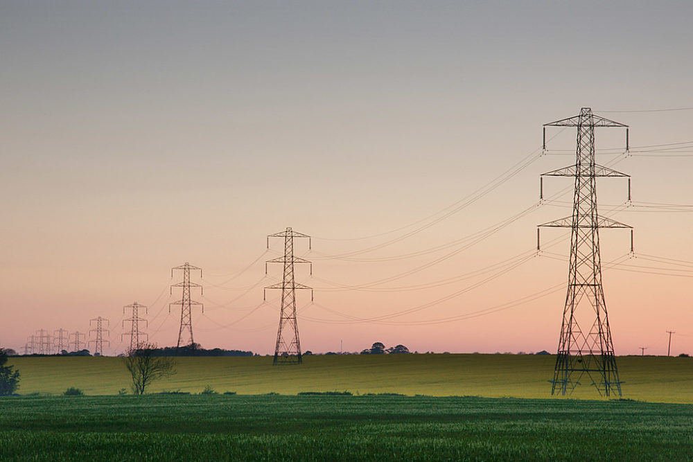 electrical wires crossing a rural landscape