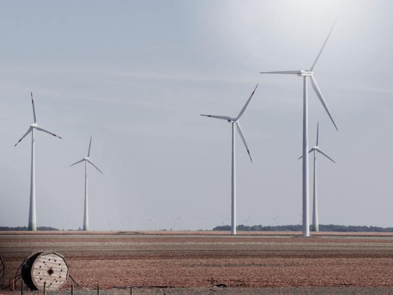 A wind farm in a nondescript rural area.