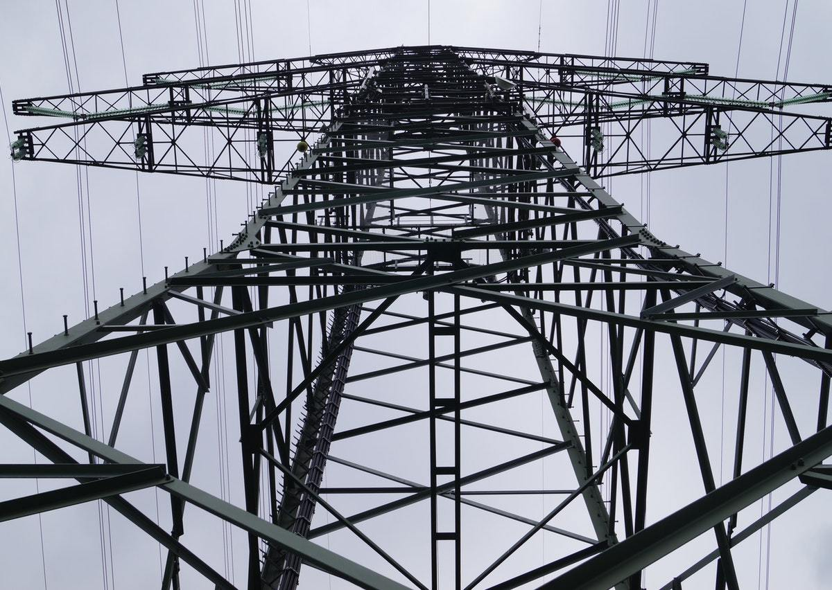 Looking up from under a transmission tower.