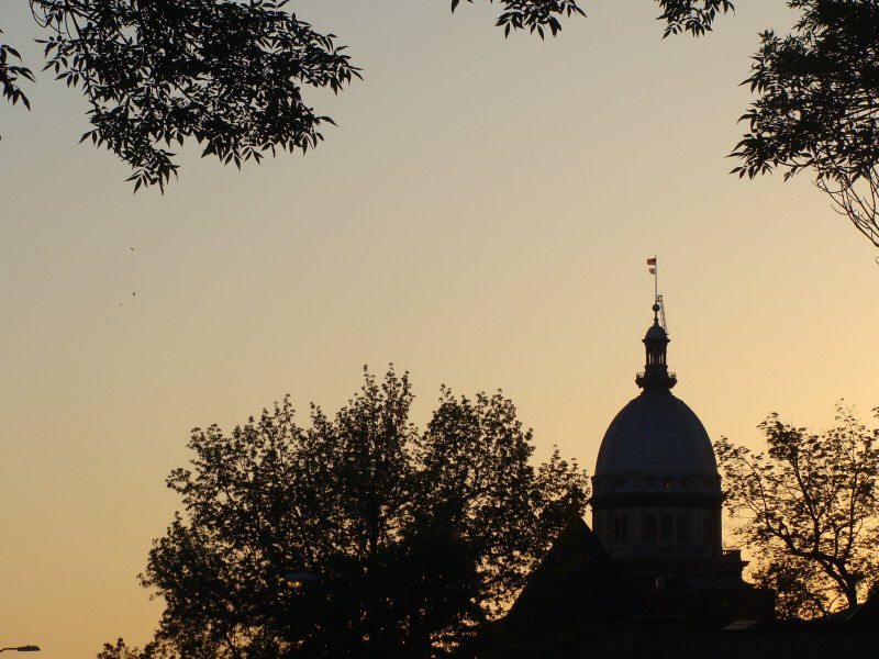A silhouetted Illinois State Capitol Building in Springfield.