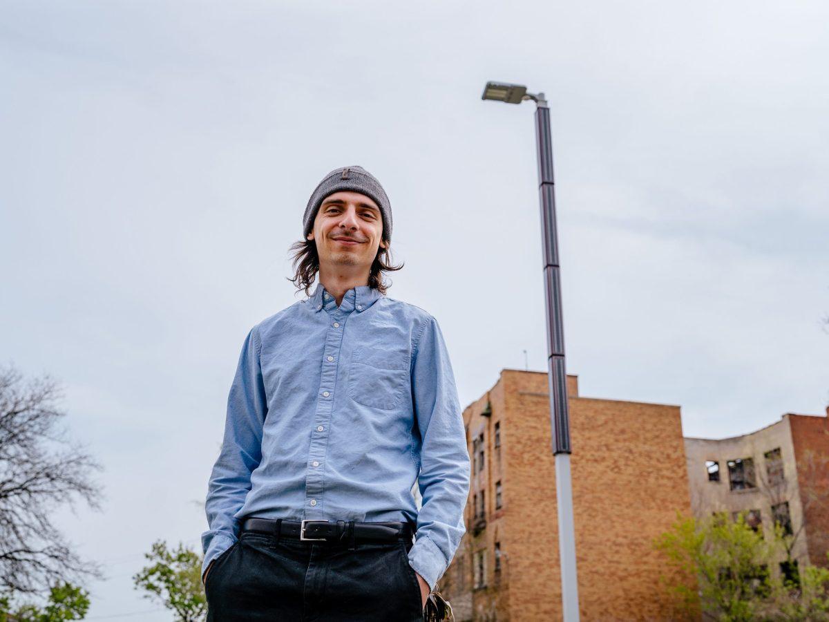Jackson Koeppel, outgoing executive director and co-founder of Soulardarity, near a solar-powered streetlight near the Soulardarity office.