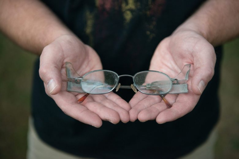 Brad Campbell holds his father Glen Campbell's glasses at his home in Herrin, Illinois.