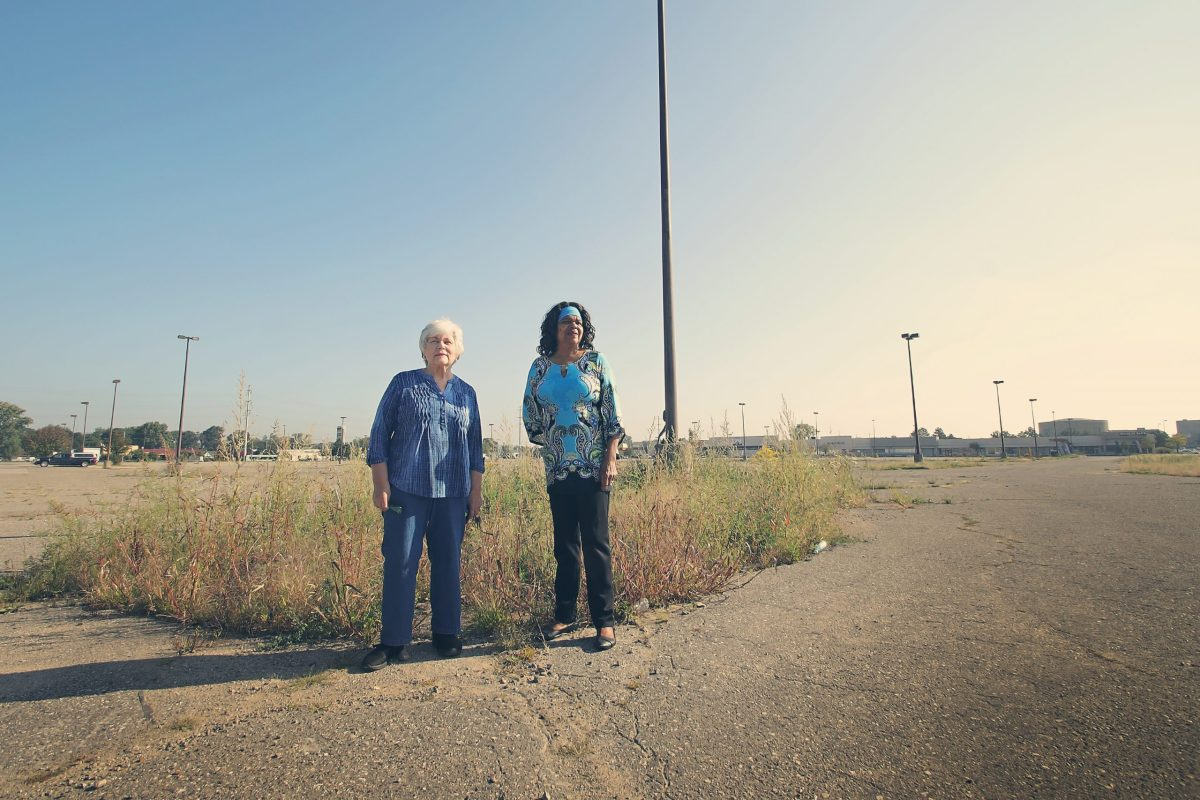 Pat Bosch, left, and Karen Washington, right, near the Bel Air shopping plaza in Detroit's Nortown neighborhood, where residents imagining new uses for large commercial sites facing vacancy and neglect.