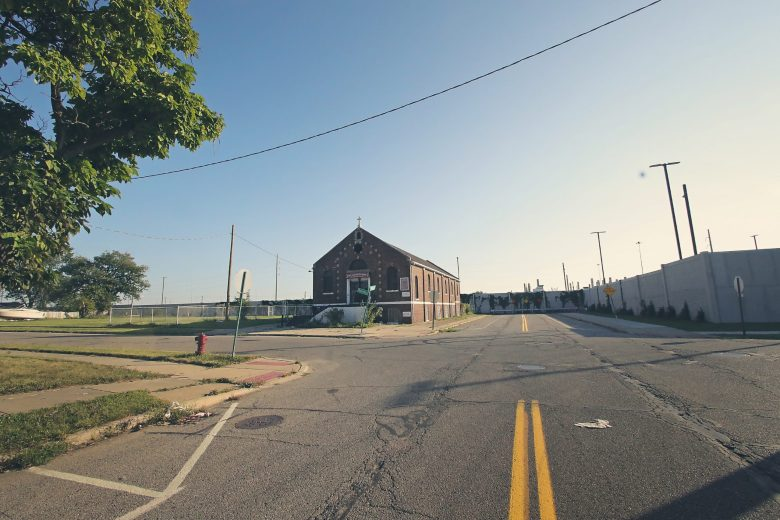 The neighborhood surrounding the Fiat Chrysler assembly plant that has been walled off from what used to be thoroughfare through the neighborhoods. Meant initially as a sound barrier, the 15-foot wall now creates a divide.
