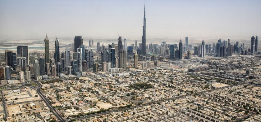 The skyline of the city Dubai from a helicopter.
