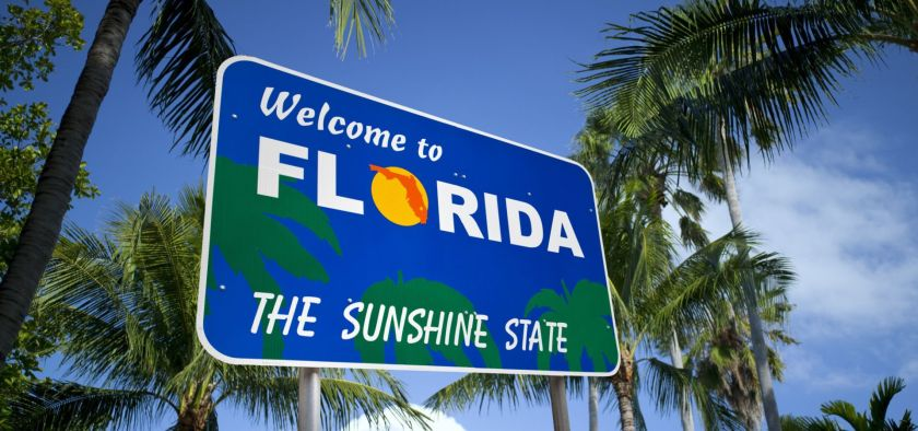 """the Sunshine State is seeing an anti-solar movement, financed by big business. """"welcome to florida, the sunshine state"""" sign"""
