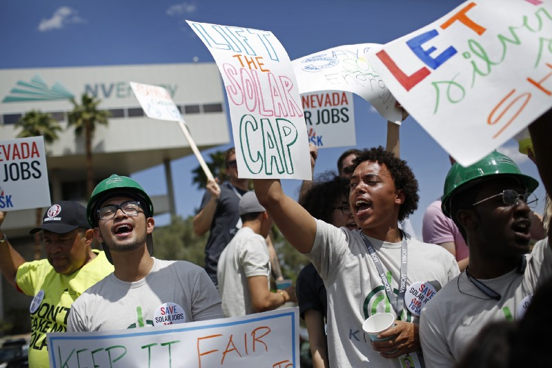 In this April 22, 2015, photo, Nevada residents protest proposal that could curtail rooftop solar in the state. The rooftop solar debate has pitted solar developers against electric utility companies. CREDIT: AP Photo/John Locher