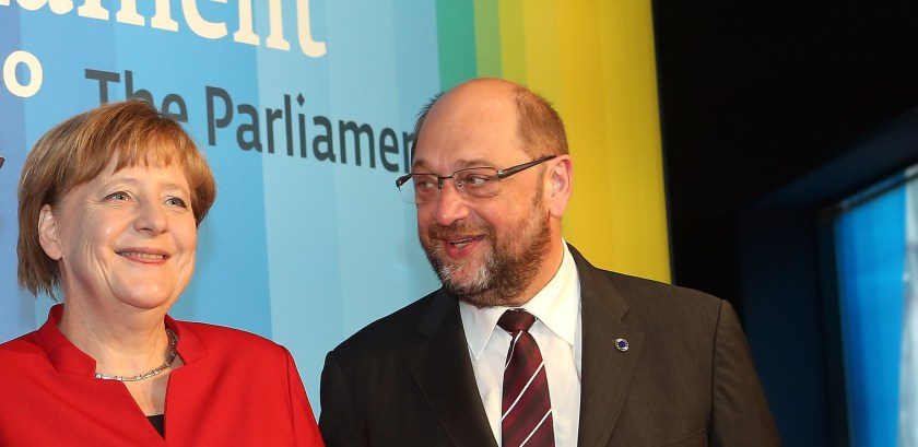 Angela Merkel and Martin Schulz smiling with a blue background