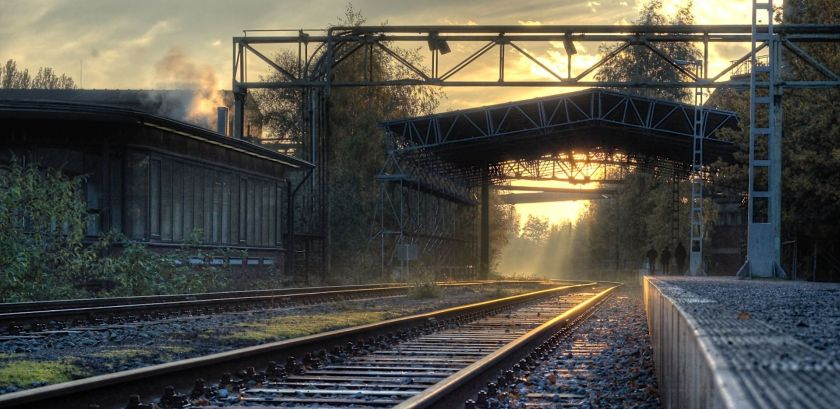 view of a German steel plant in the early morning with mist