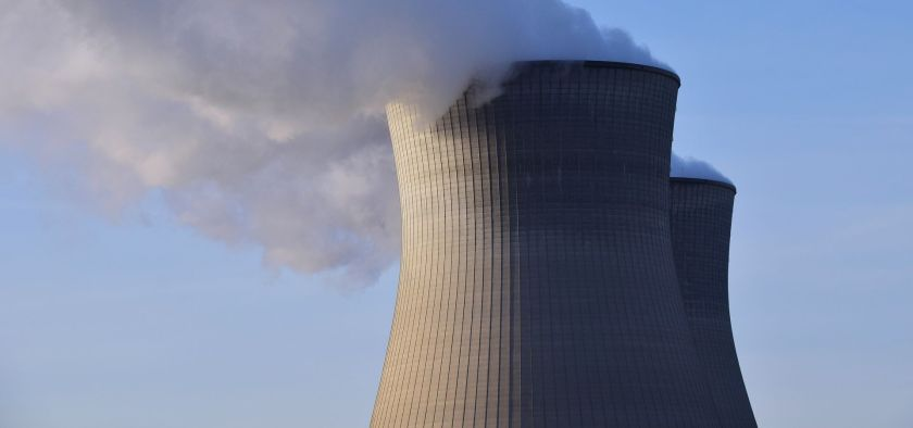 Two smoking chimneys of a nuclear power plant