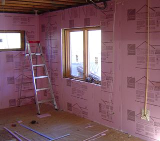 XPS foam board insulation on the inside of concrete foundation walls