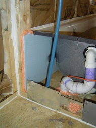 home building insulation and air barrier behind bathtub