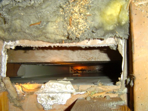 air-leakage-building-enclosure-hole-fiberglass-insulation.jpg