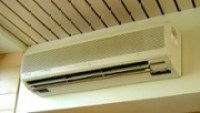 A ductless mini-split heat pump head is visible in the home.