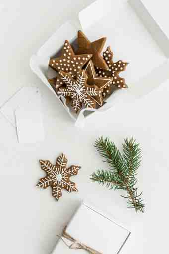 Royal icing on a gingerbread snowflake cookie cutout, for Christmas cookies