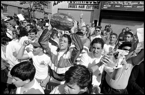 © Ricky Flores. African-American protesters take to the streets in Bensonhurst in Brooklyn after the acquittal of Keith Mondello on the charge of manslaughter in the death of Yusef Hawkins  on May 19, 1990 ( Ricky Flores )  Protesters were met by jeers and curses from a mostly Italian community during the demonstration.