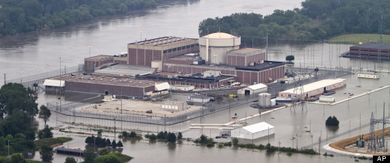 This photo from June 14, 2011 shows the Fort Calhoun nuclear power plant surrounded by flood waters from the Missouri River, in Fort Calhoun, Neb. Officials said on Wednesday, July 27, 2011, that  the power plant will be thoroughly inspected and any flood damage repaired before the plant restarts sometime this fall. (AP Photo/Nati Harnik)