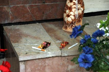 Flowers, chocolates, and cigarettes left on the alter for Valery Khodemchuck.