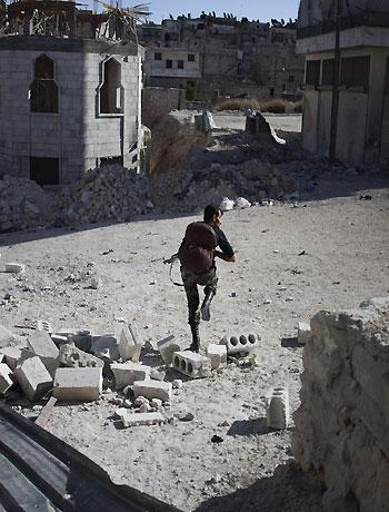 Jets hit town, Syria envoy flies in on truce bid