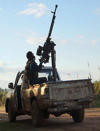 Russia says Syrian rebels might win; car bomb kills 16