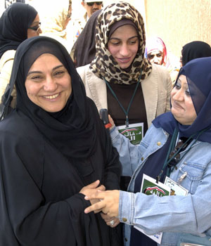 Women vote and run for office for first time in Kuwait