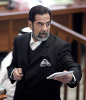 Judge's observation that Saddam 'not a dictator' sparks call for him to resign