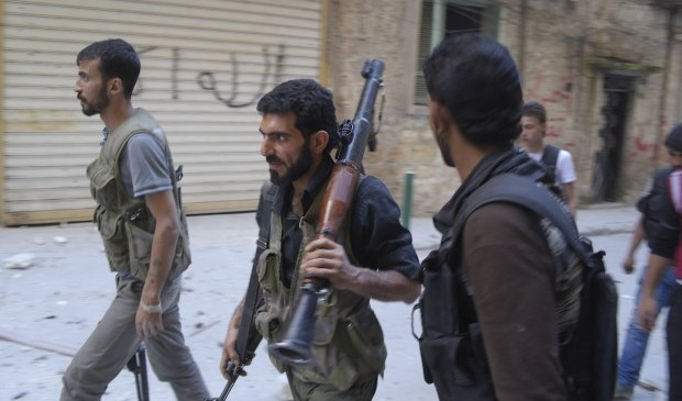 US Source: State Department or CIA to Serve as Conduit for Arming Syrian Rebels