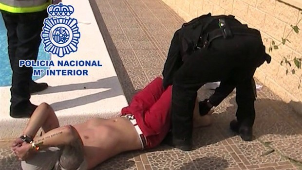 British fugitive nabbed by pool in Spain
